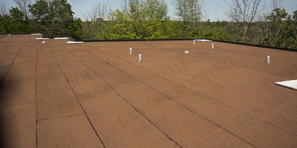 Modified bitumen flat roof replacement commercial roofing